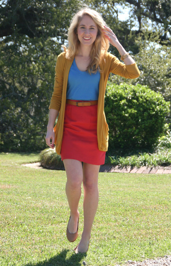 Mustard cardigan, blue top, and red belted skirt