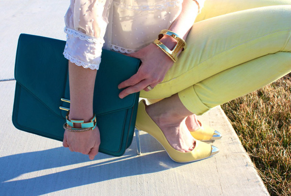 Yellow skinnies, yellow heels, teal purse, and gold bangle