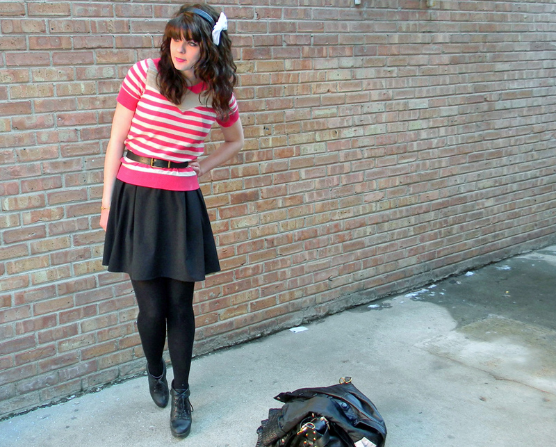 Pink striped top, black skirt, black tights, and black booties